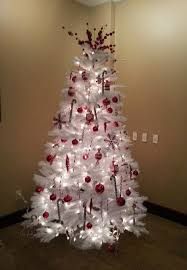 white tree decorated with white lights and ornaments