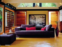 cottage living room interior using purple fabric couch also wooden