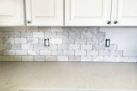 tiles for backsplash in kitchen how to install a marble subway tile backsplash just a and