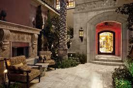 Custom Home Interiors Charlotte Mi Front Entryway Porch Italian Fireplace Mediterranean Custom Home