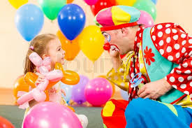 clowns for a birthday party happy child girl and clown on birthday party stock photo