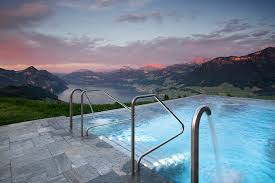 outdoor infinity edge pool at hotel villa honegg in switzerland