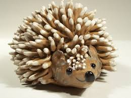 custom hedgehog folkart sculpture by sandra lance pottery