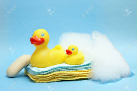 Conceptualize A Group Of Rubber Duckies And Other Bathing Items Come Together