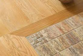 transitions from tile to a wood floor in a doorway home guides
