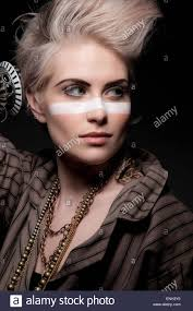 adam ant style fashion portrait of young woman with blonde quiff