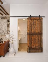 a rustic wooden sliding door idea in a brown marble flooring