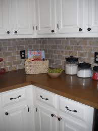 vinyl kitchen backsplash our diy brick backsplash using vinyl floor tiles cut into mini