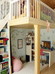 a large childrens bedroom furnished with a pine bed with posts and