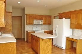 what color countertops go best with golden oak cabinets picking quartz to go with oak