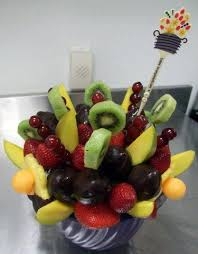 edible arragement early morning at edible arrangements preparing fruit and