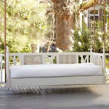 hanging bed with white color of bedlinen pillows on terrace with