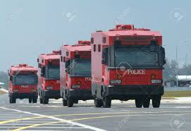 police truck four armoured red police trucks special forces for riot control
