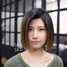 blunt cut bob hairstyle photos women s blunt cut bob with textured ends and brunette balayage