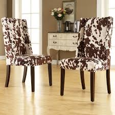 cowhide pattern wingback dining room chair mixed antique console