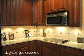 kitchen backsplash tile with white cabinets and modern accent for