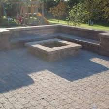 Backyard Paver Patio Ideas Paver Patio With A Techo Bloc Fire Pit And Built In Sitting Bench