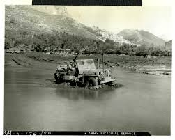 white jeep stuck in mud the digital collections of the national wwii museum oral