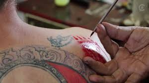 you can get a tattoo at this hell temple in thailand you just can