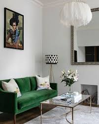 chic eclectic living room with emerald green sofa deep greens