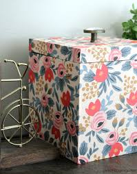 in wrapping paper wood box makeover with wrapping paper girl in the garage