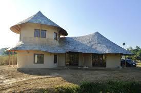 2 storey bamboo earth family home by chiangmai life construction