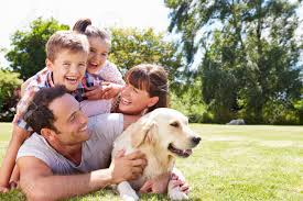family garden family relaxing in garden with pet dog stock photo picture and