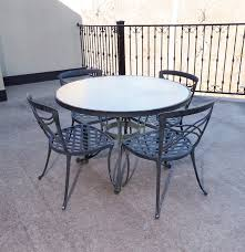 cast aluminum patio table and chairs by brown jordan ebth