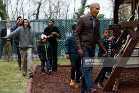 Obama First Family by President Obama Plays With Children On A Swing Donated By The