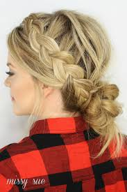 put your hair in a bun with braids dutch braids and low messy bun