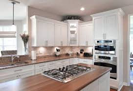 kitchen with white cabinets and wood countertops spotlight on wood countertops k s renewal systems llc