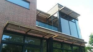 modern design incorporating wood trellis over windows wood