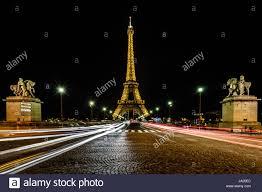 eiffel tower light show paris june 29 eiffel tower light show and traffic light trails on