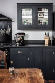 grey kitchen cupboards with black worktop the many advantages of black kitchen countertops decorated