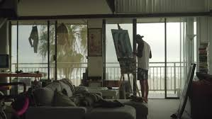 artist drawing painting pictures at his creative loft apartment in