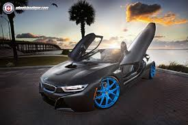 Bmw I8 Wrapped - this matte black wrapped bmw i8 with blue hre wheels looks the