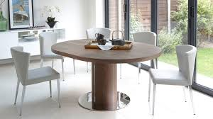 dark brown round kitchen table curved dining chair chrome tapered legs faux leather
