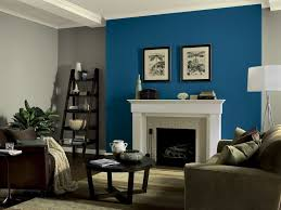 photograph blue wall modern fireplace standing lamp round table