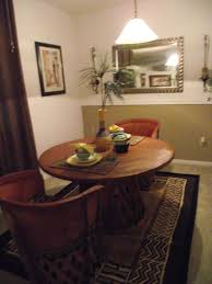mexican equipale furniture and goodwill dishes in my dining space