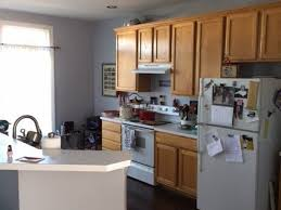 how to paint kitchen cabinets brown what color to paint kitchen cabinets hometalk