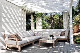modern white outdoor family room ideas with a wooden patio and