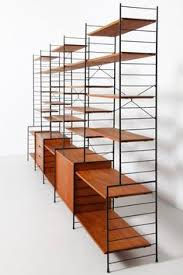 a free standing shelving unit achieves a minimal look which is