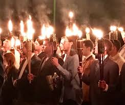 white nationalist protesters carrying tiki torches draw mockery