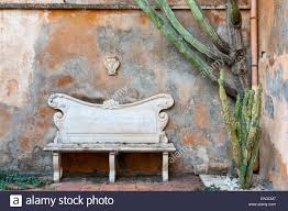 il biviere garden sicily italy a marble bench inscribed with