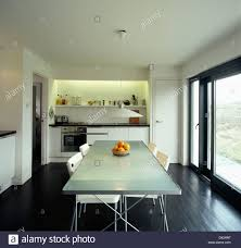 modern kitchen dining wooden flooring and glass patio doors in modern kitchen extension