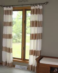 make striped curtains from a bedsheet and an old bedskirt a