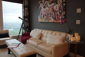 Navy Accent Wall by A Brown Accent Wall Off Sets The Cream Colored Tufted Leather