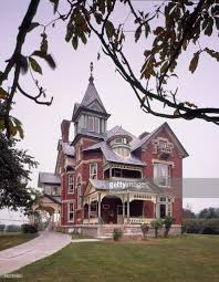 queen anne victorian exterior view southern brick queen anne victorian home stock photo