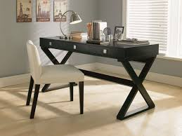 long black wooden corner desk with crossed legs also triple