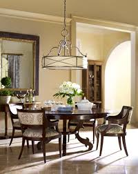 Tiledwallpapered Walls In A Dining Room Spanish Style Chandeliers - Dining room spanish